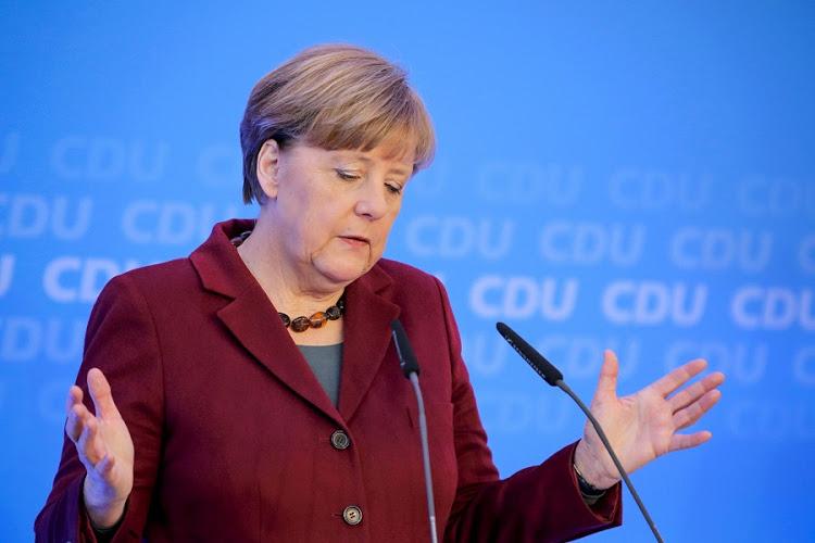 Merkelova_reaguje_na_utoky_Trumpa_okolo_podhodnotenia_eura_2017