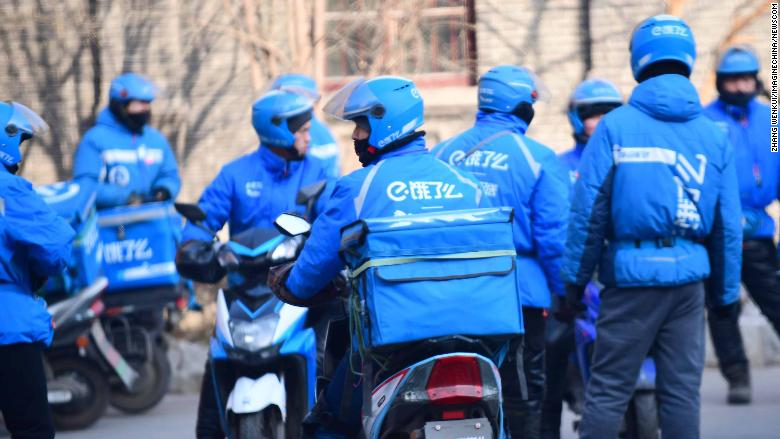 --FILE--Food delivery couriers of Chinese meal delivery company Ele.me ride their electric bikes to deliver meals on a street in Shenyang city, northeast China's Liaoning province, 1 February 2018. Congee with preserved egg and pork was the most popular food ordered online in China's booming food delivery market in 2017, with nearly 19 million orders made on ele.me, a leading online food delivery service. The spicy Zinger Burger and sour shredded potato take second and third place, according to a report released by the company. Rival takeaway service meituan.com said that 130 million people used their online food delivery service in 2017, with 3.93 million customers placing more than 100 orders ? an average of two orders a week. According to a report on the online food delivery industry by ASKCI Consulting, a leading industry research institute, the value of China's online food delivery is expected to reach 230 billion yuan (about 36.5 billion U.S. dollars) in 2018, exceeding the 200 billion yuan reported for 2017 (31.8 billion U.S. dollars). This reflects the growing number of online food delivery service users, which increased from 135 million to 343 million between 2016 and 2017. The number of mobile food delivery users reached 322 million in 2017, an increase of 66.2 percent from the previous year. (Newscom TagID: ichphotos290319.jpg) [Photo via Newscom]